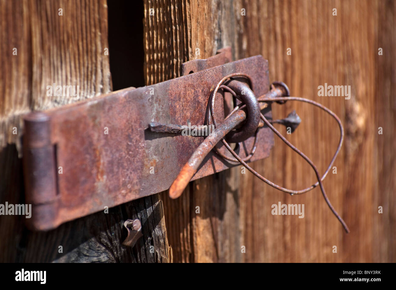 Rusty hinge from building in the historic Ghost Town of Bodie Hills State Park California - Stock Image