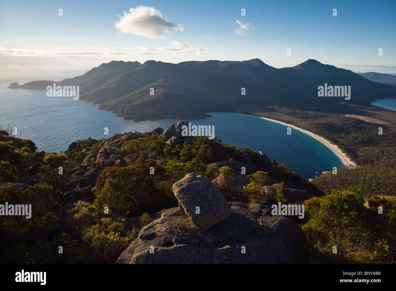 Sunrise view of Wineglass Bay from Mt Amos. Freycinet National Park, Tasmania, AUSTRALIA. - Stock Image