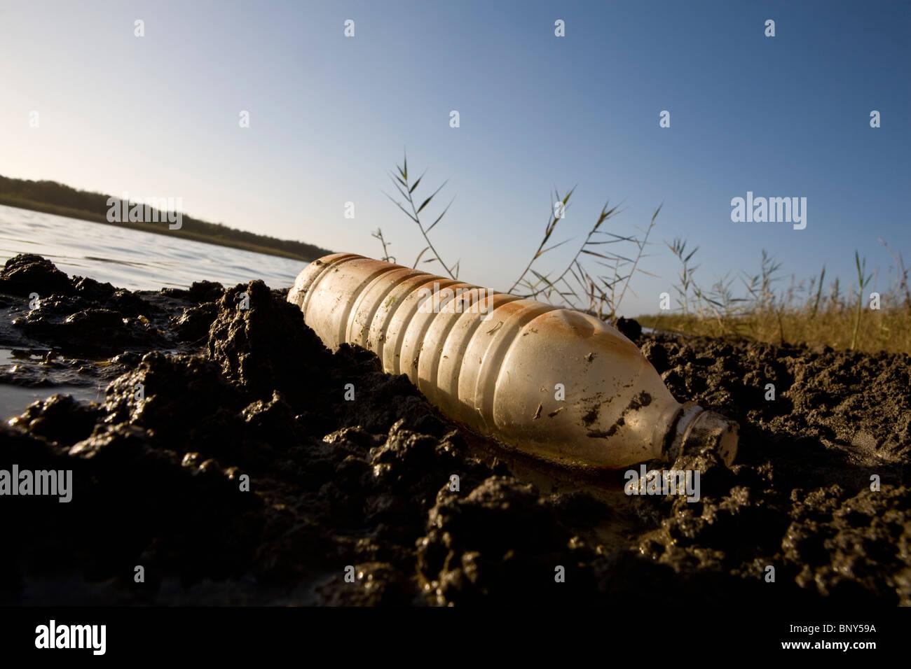 Plastic water bottle littering water's edge, Souss-Massa National Park, Morocco - Stock Image