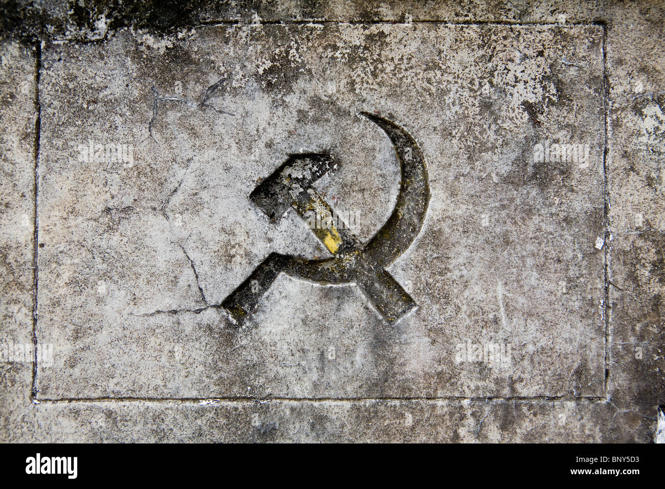 Hammer and sickle symbol on gravestone, Hang Duong Cemetary on Con Son Island, Vietnam - Stock Image