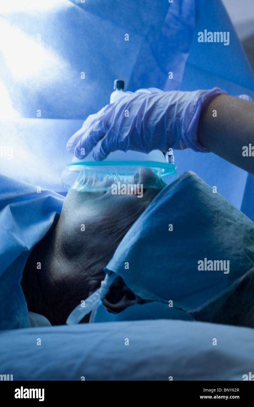 Patient receiving oxygen during operation - Stock Image