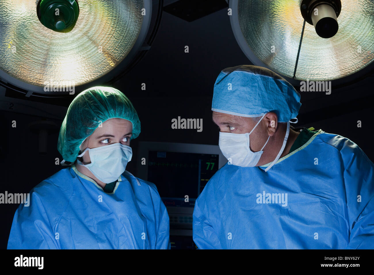 Surgical team at work in operating room - Stock Image