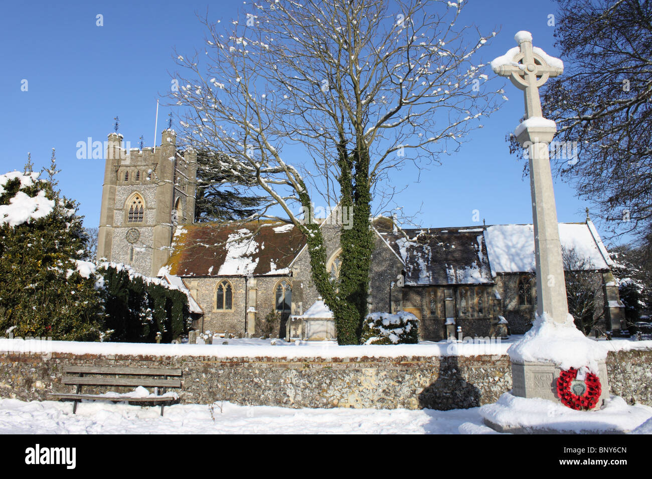 Saint Mary's Church and War Memorial, Hambleden village in the snow, Chiltern Hills, Buckinghamshire, England, - Stock Image