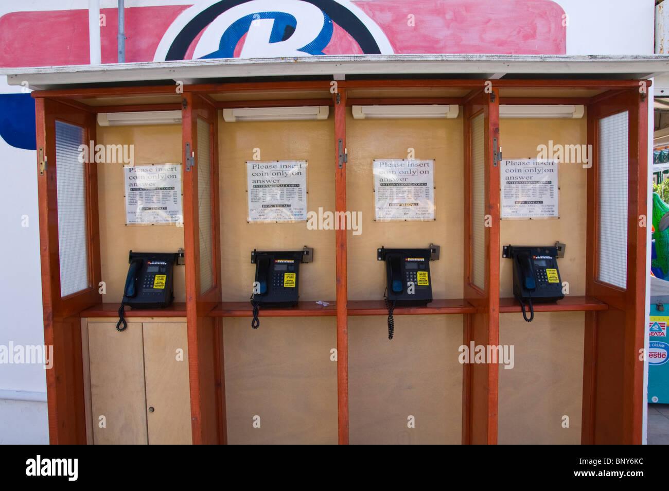 Public telephones in Sidari on the Greek island of Corfu Greece GR - Stock Image