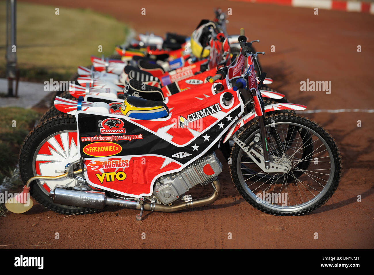 Speedway bikes are lined up on the track before racing  - Stock Image