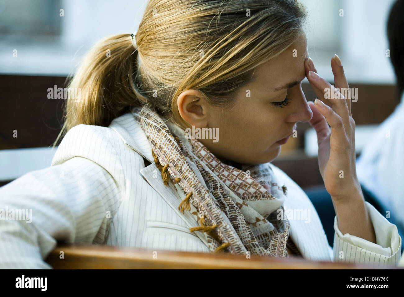 Woman suffering from a headache - Stock Image