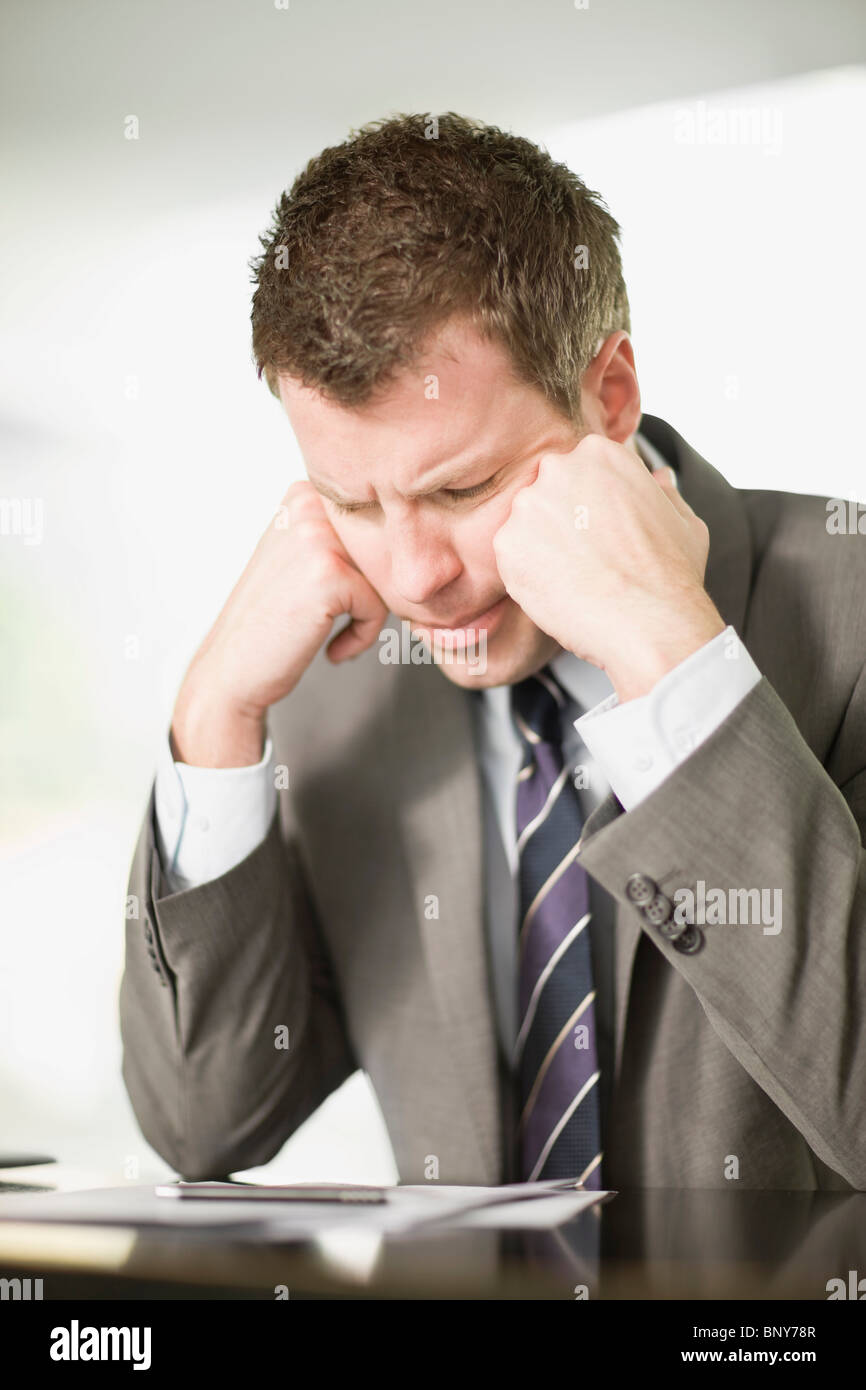 Business man in trouble - Stock Image