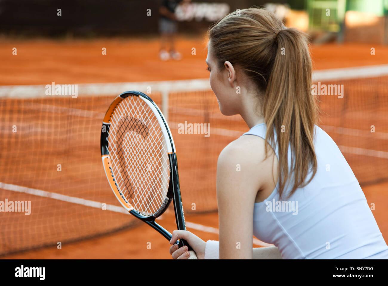 Teenage girl playing tennis - Stock Image