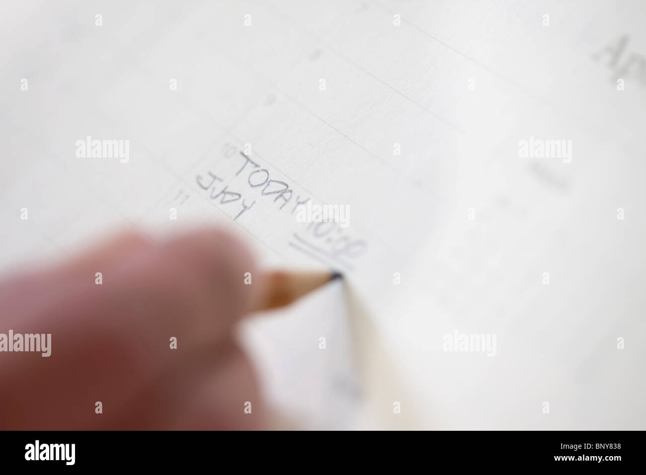 Making a note - Stock Image