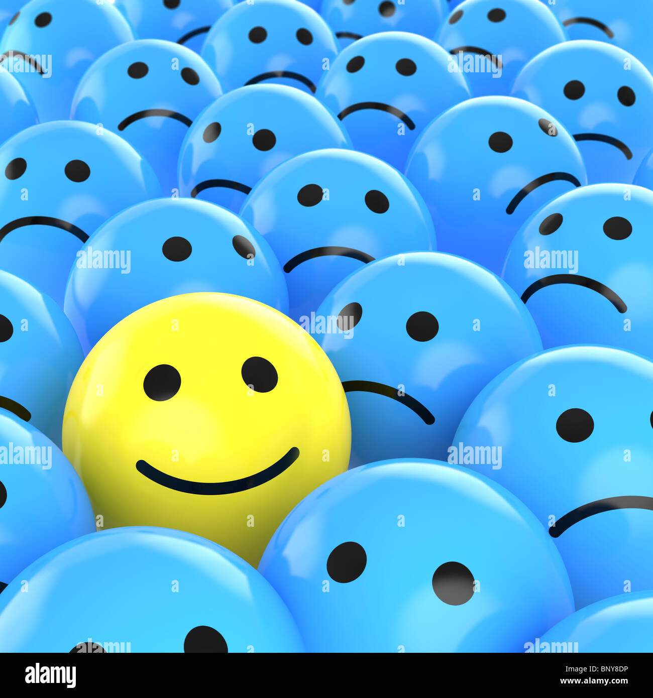 a yellow happy smiley between many blue sad others as concept for unique, optimistic, positive, etc. - Stock Image