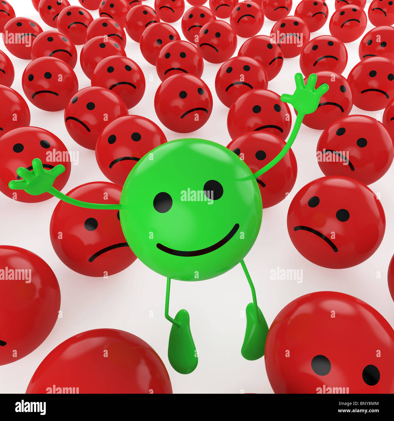 A green smiley happy jumping among many sad red others as concept for unique, optimistic, hapiness, difference. - Stock Image