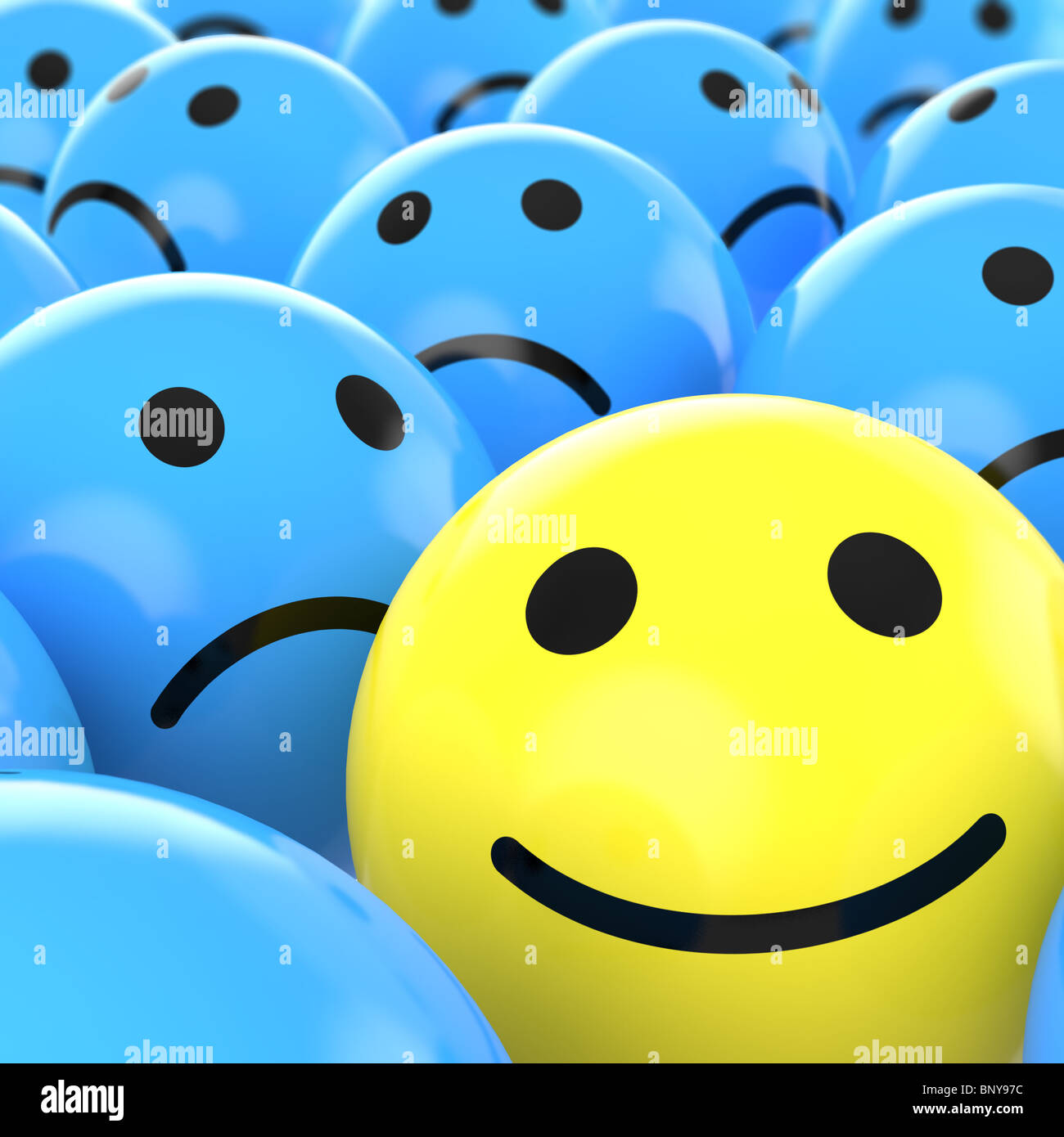 close up of a yellow happy smiley between many blue sad others as concept for unique, optimistic, positive, etc. - Stock Image
