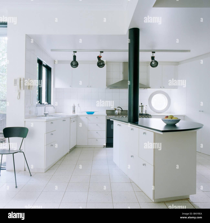 White Ceramic Floor Tiles In Modern White Kitchen With Black