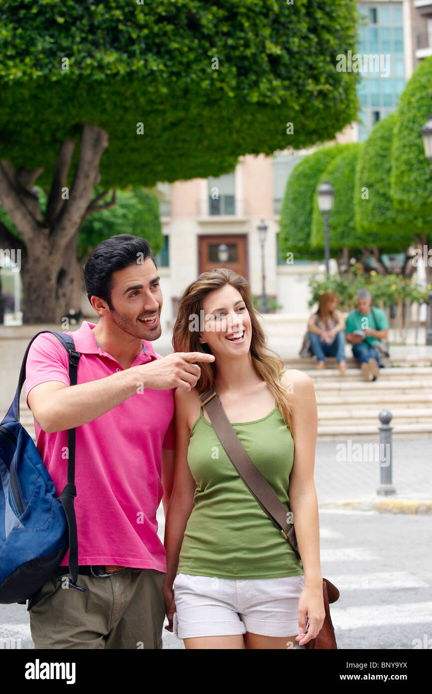 Tourist couples sightseeing - Stock Image