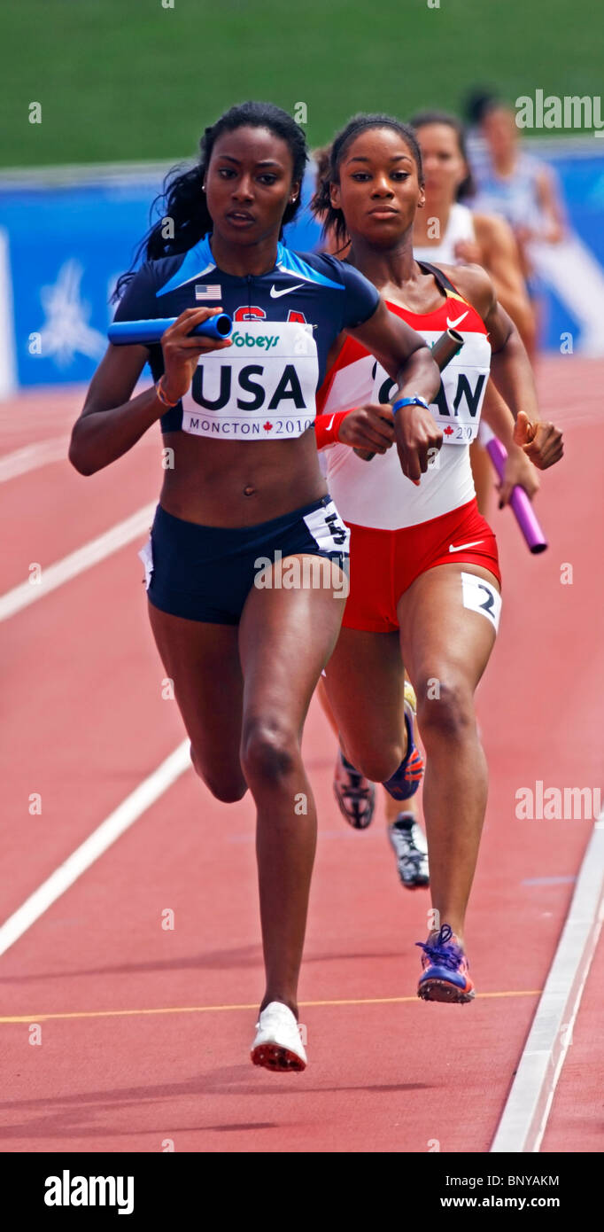 Briana Nelson of USA and Chanice Chase of Canada in women's 4x400 metres at  2010 IAAF World Junior Championships - Stock Image