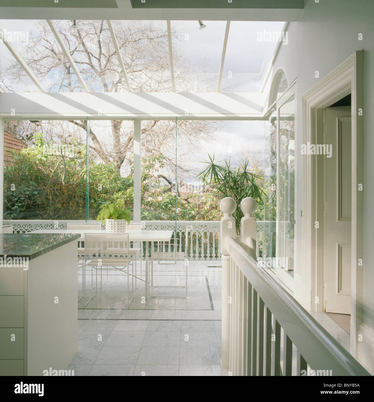 Large Modern White Kitchen Dining Room Extension With Glass Roof And Wall