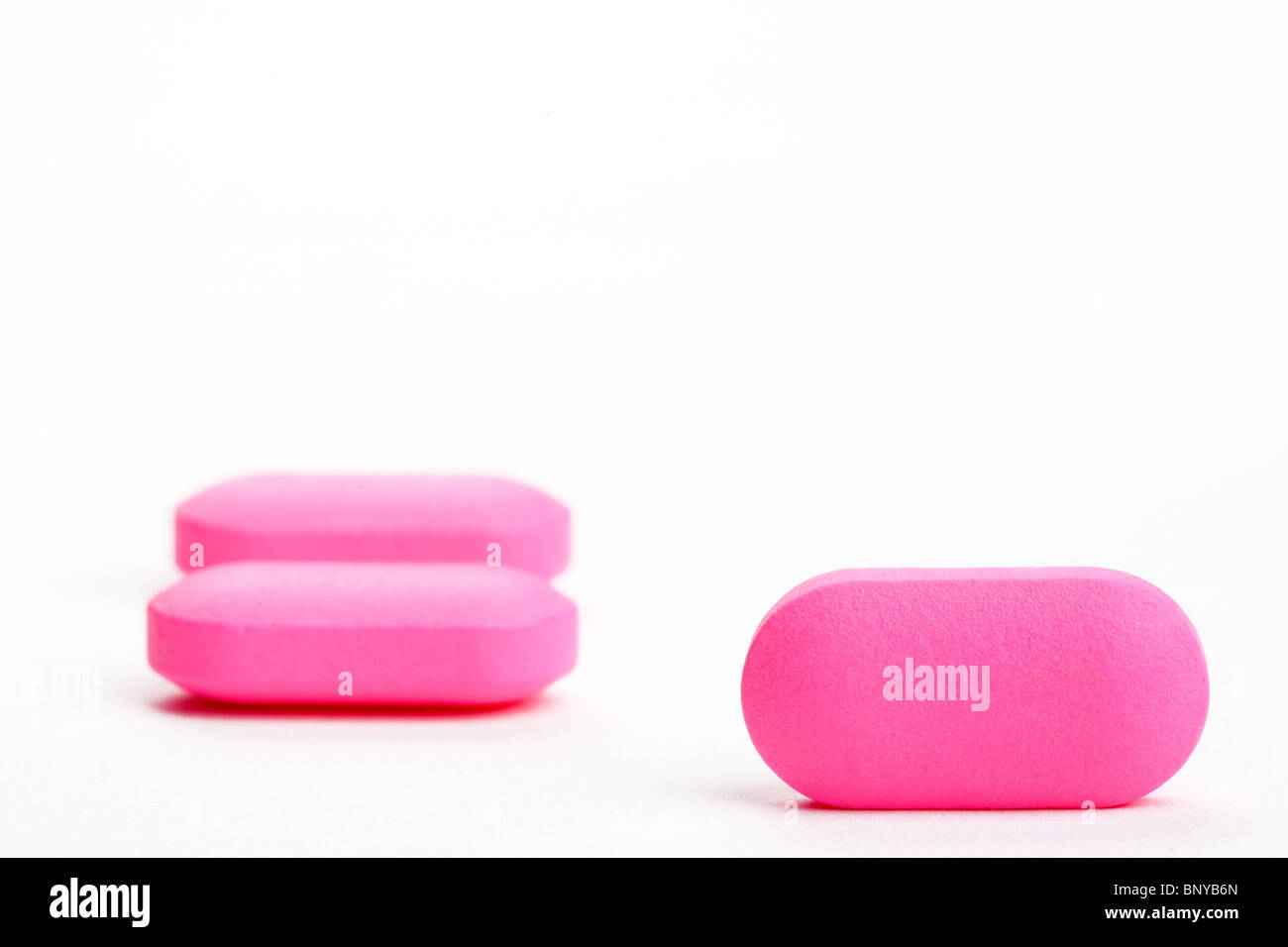 closeup of pink medical pills, isolated - Stock Image