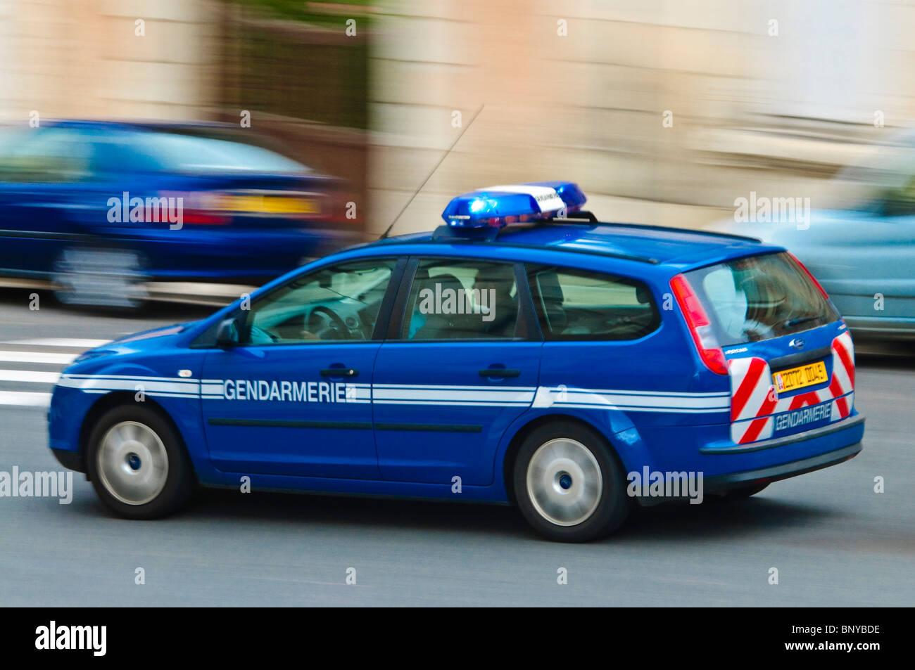 Speeding French Gendarmerie police car. - Stock Image