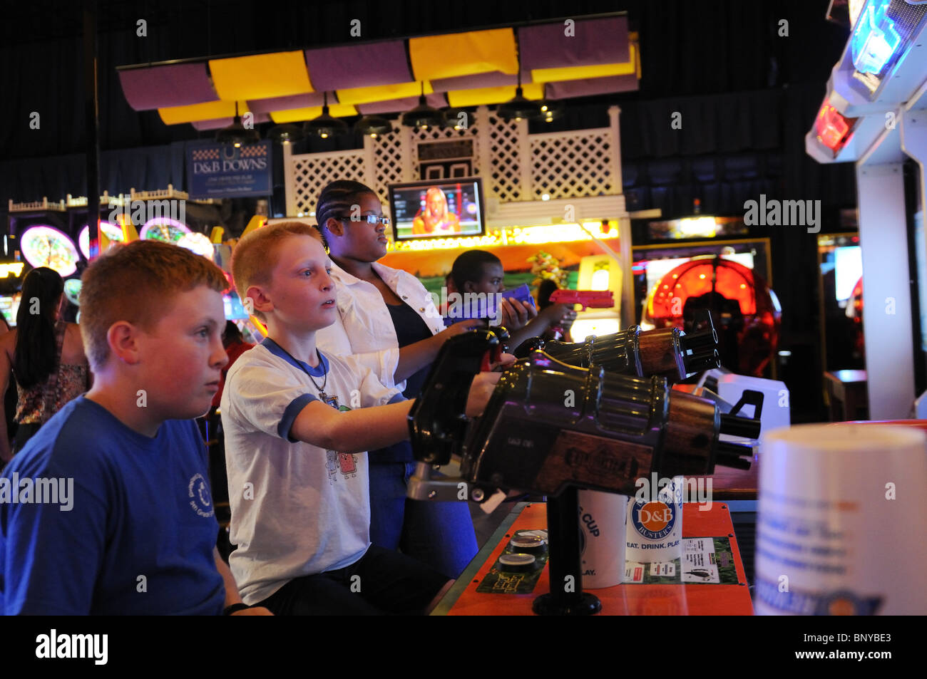 People playing video games at an arcade in midtown Manhattan. - Stock Image
