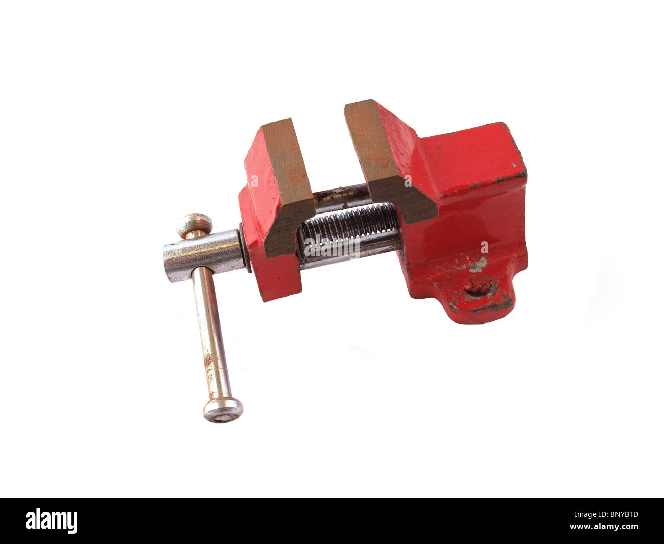 Red vice on an isolated white background. - Stock Image
