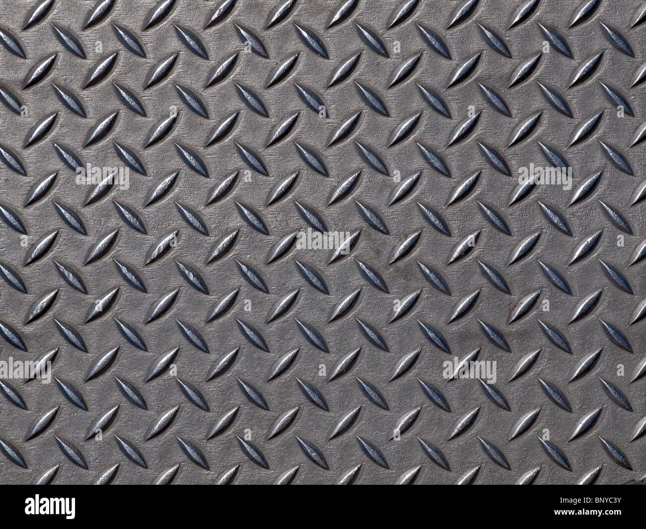 Worn steel road plate. Grunge background texture. - Stock Image