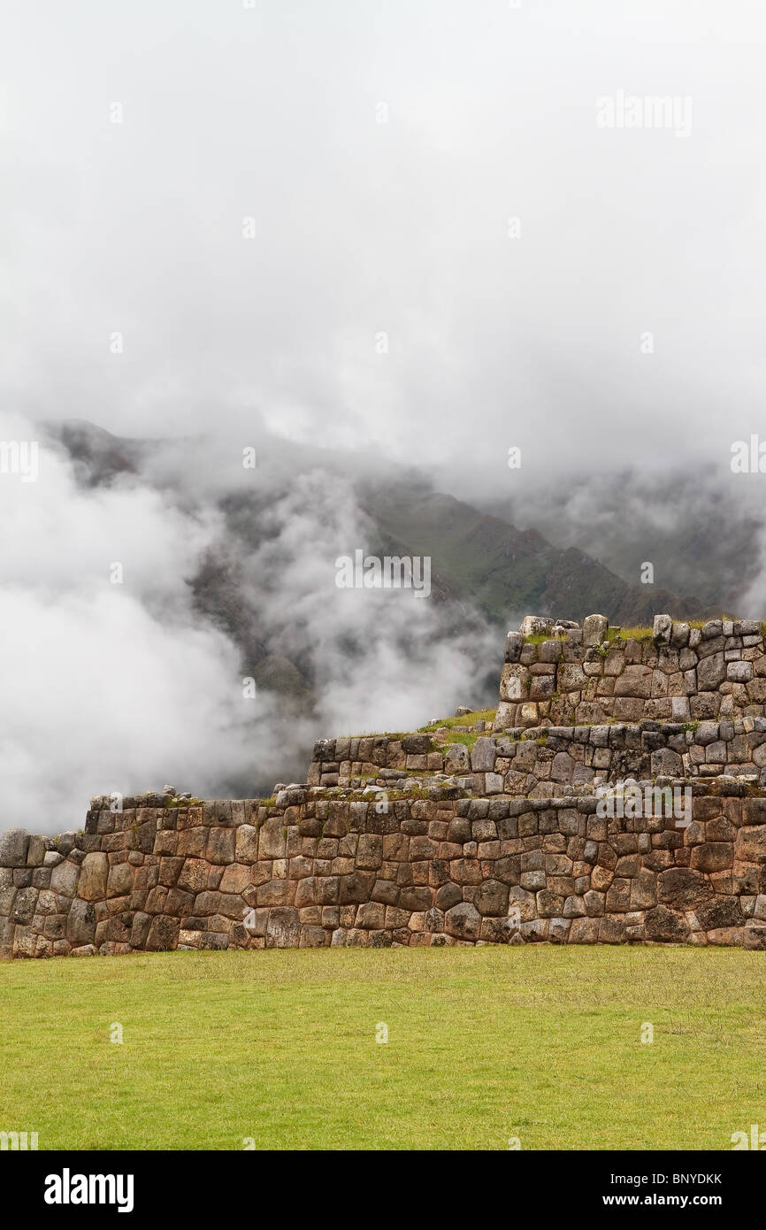 View of Chinchero, near Cusco in Peru. The fog gives the picture a very mystical touch. - Stock Image