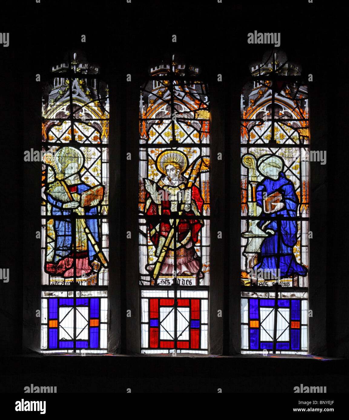 A 16th century stained glass window depicting Saints Cuthbert, Chad and Giles, All Saints Church, Ladbroke, Warwickshire - Stock Image
