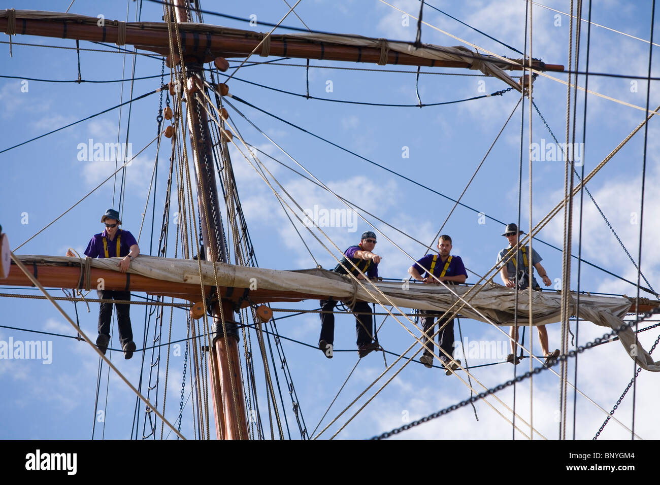 Sailors on the mast of a traditional sailing ship, during the Wooden Boat Festival.  Hobart, Tasmania, AUSTRALIA - Stock Image