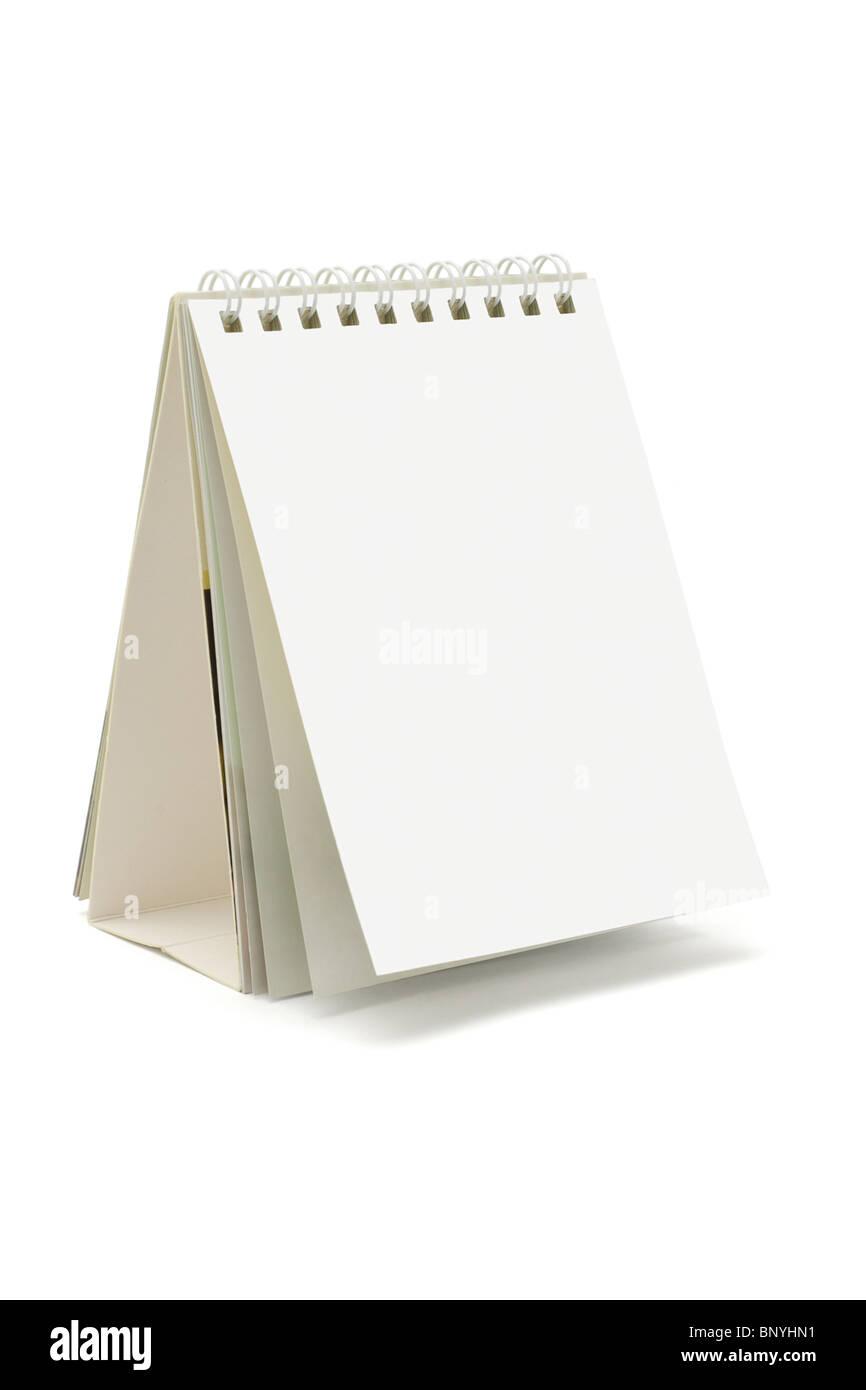 Blank desktop calendar standing on white background - Stock Image