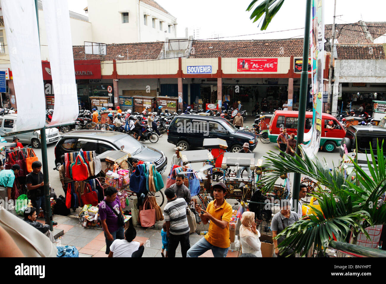 Busy street in front of Pasar Baru in Bandung, Indonesia. - Stock Image