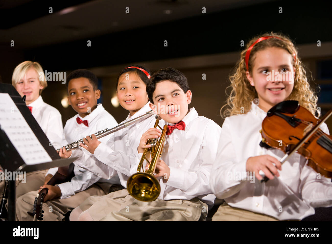 Children playing musical instruments in band - Stock Image
