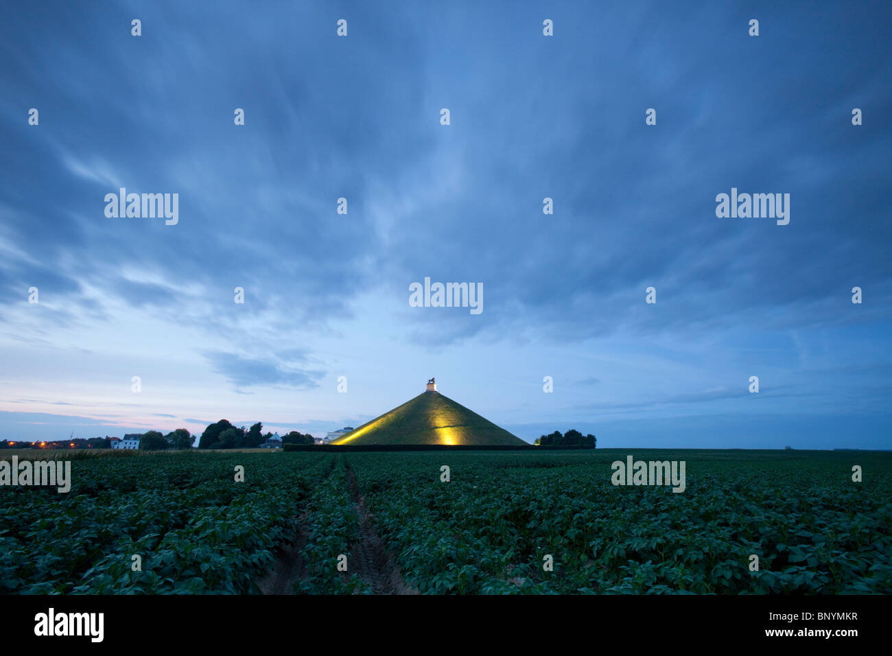 Wide angle shot during blue hour of the Lion Mound, a monument marking the battle of Waterloo, Belgium. - Stock Image