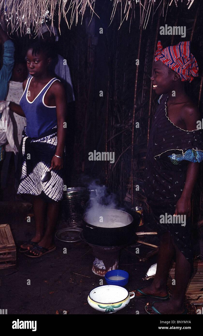 sisters cooking in Monrovia Liberia circa 1994 - Stock Image