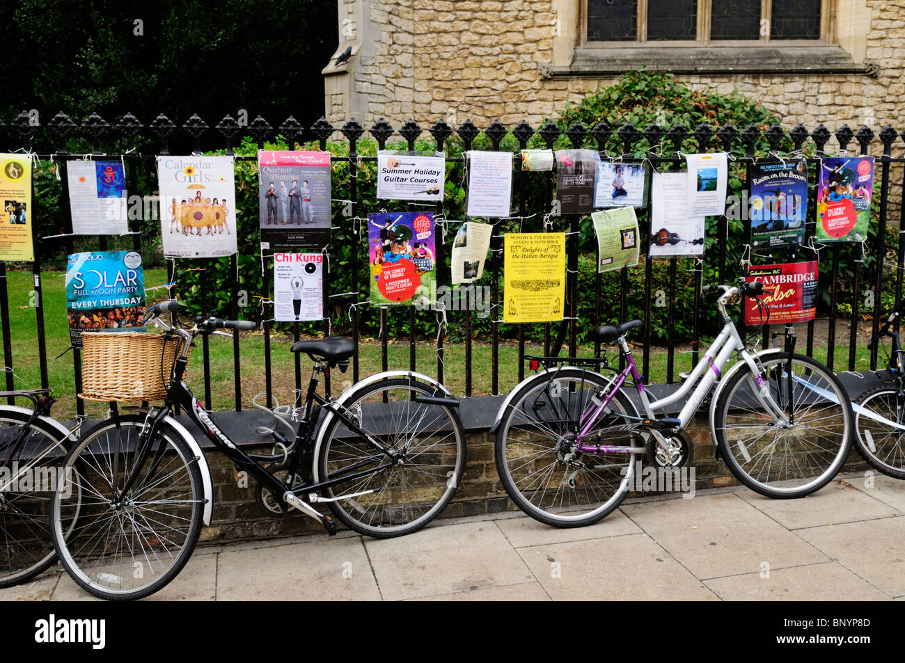 Bicycles and Posters outside Great St Mary's Church, Cambridge, England, UK - Stock Image