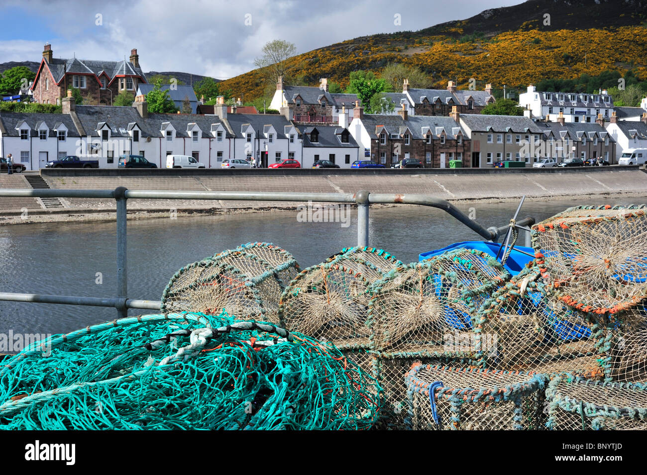 Stacked lobster creels / traps in the Ullapool harbour, Highlands, Scotland, UK - Stock Image