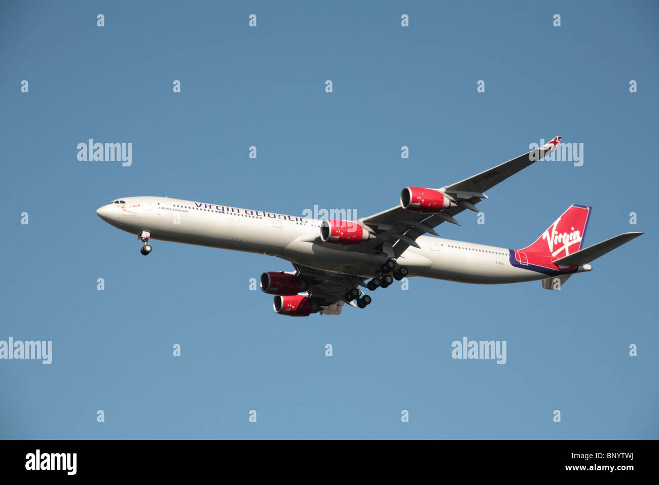 Virgin Atlantic Airbus A340-600 on final approach to Heathrow Airport - Stock Image