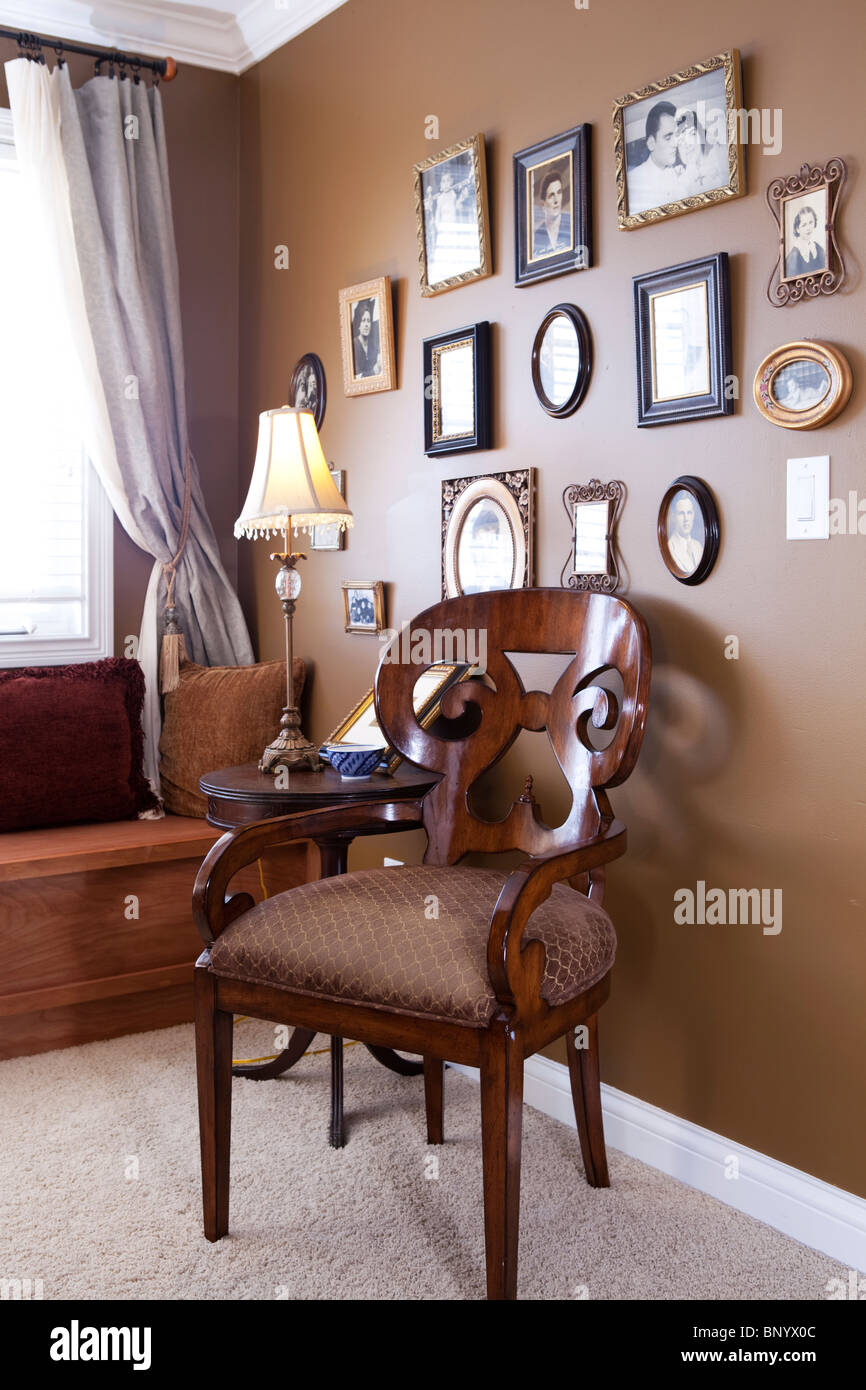 Memories corner with pictures frames showing antique family photos. American home - Stock Image