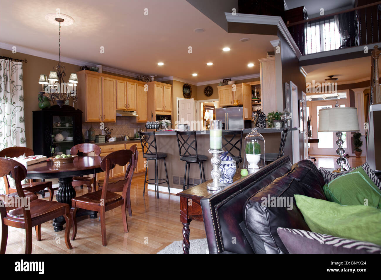 American Kitchen With Dining Room Annexed And Open Space Towards Living Room  With Leather Sofa