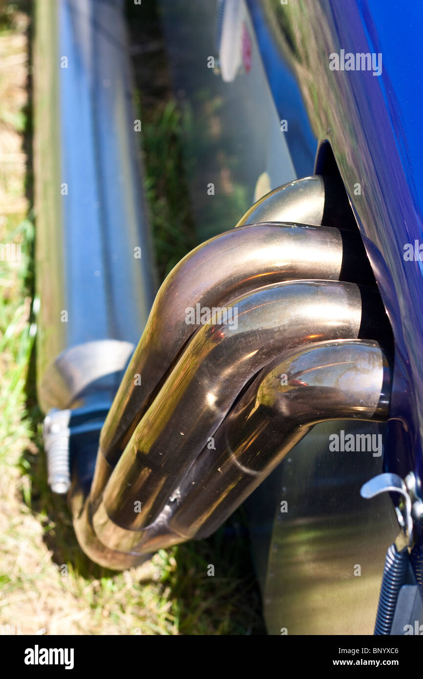 Four in one polished exhaust manifold and silencer on racecar Stock Photo
