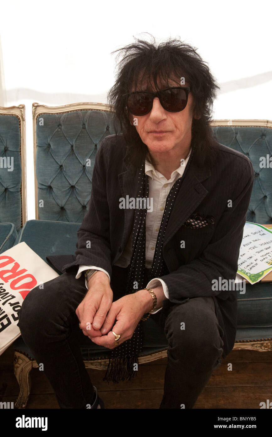 John Cooper Clarke backstage at the Latitude festival,Henham Park, Suffolk, England, United Kingdom. - Stock Image