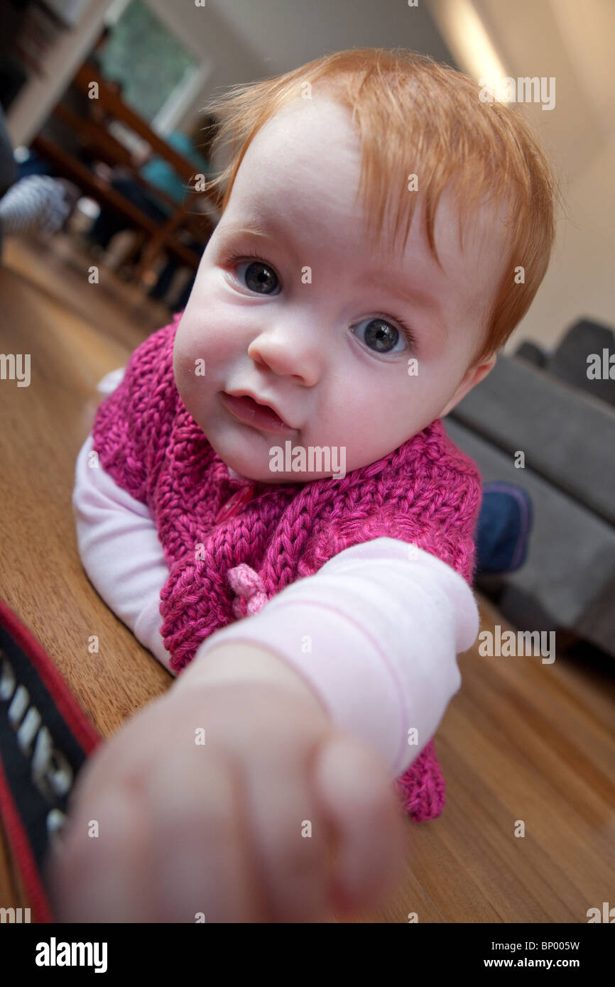 Auburn haired baby girl Stock Photo