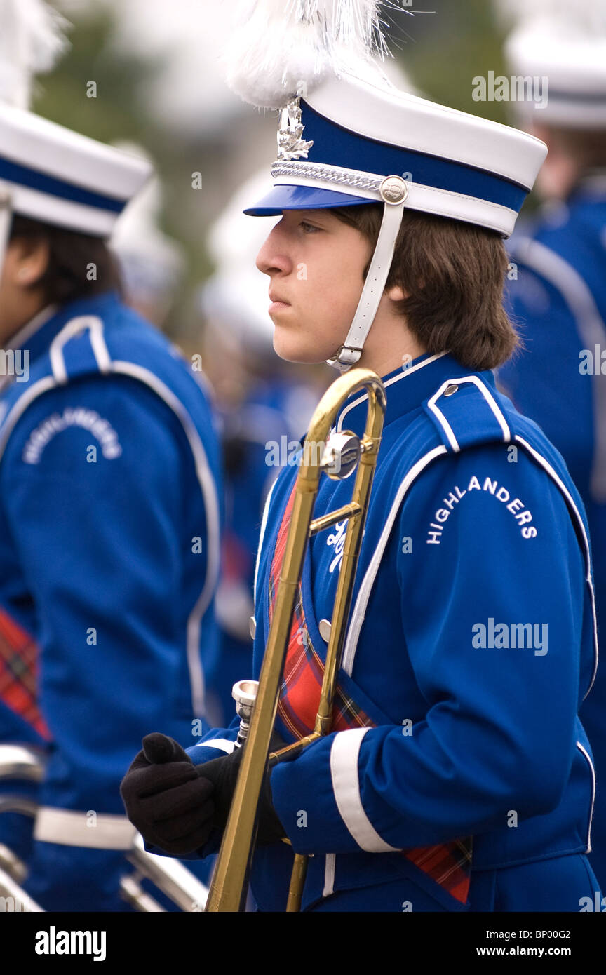 A teen aged band member with trombone at the La Habra Corn Festival parade - Stock Image