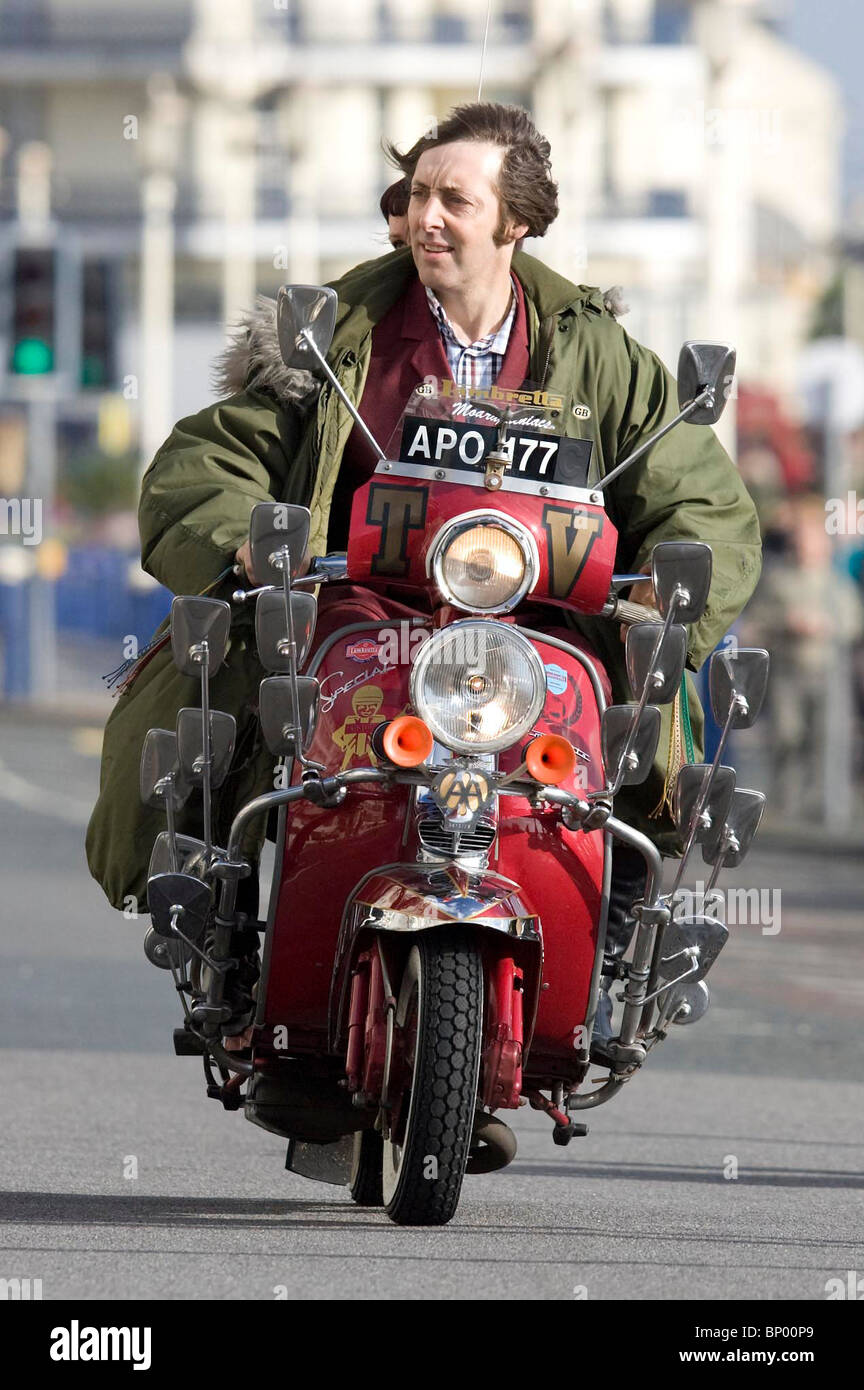 A film extra  rides along Eastbourne Seafront  during the film of Brighton Rock Picture by James Boardman - Stock Image