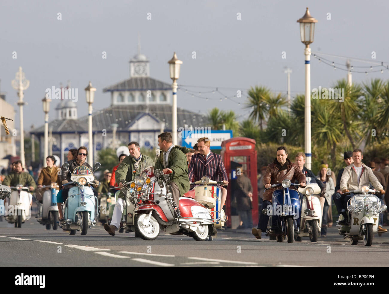Film extras ride along Eastbourne Seafront on scooters during the filming of Brighton Rock. Picture by James Boardman - Stock Image