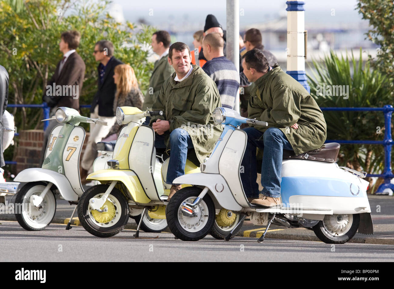 Film extras on Eastbourne Seafront sit on scooters during the filming of Brighton Rock. Picture by James Boardman - Stock Image