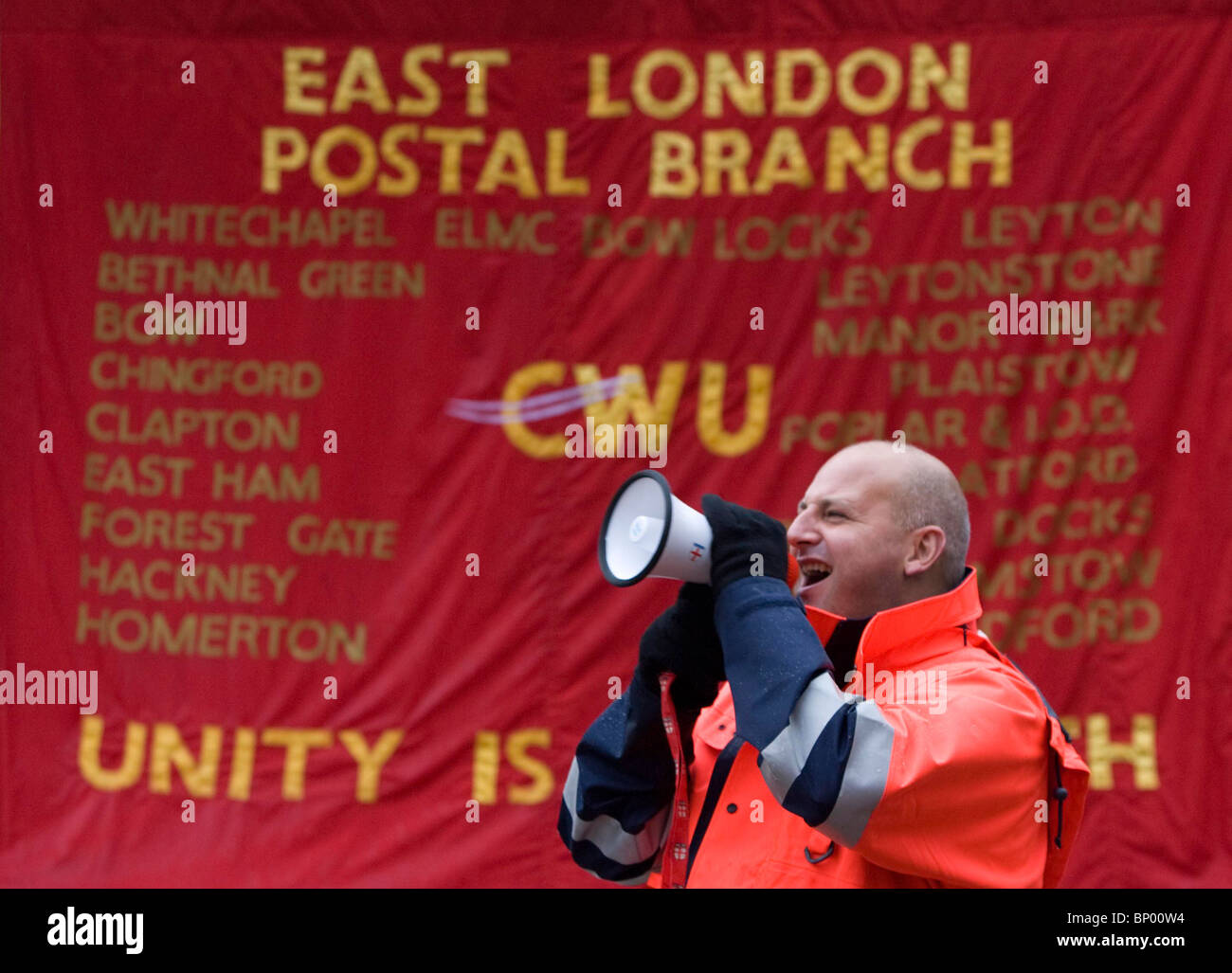 A  striking Postal Worker picket outside Bow Delivery Office in East London. Picture by James Boardman - Stock Image
