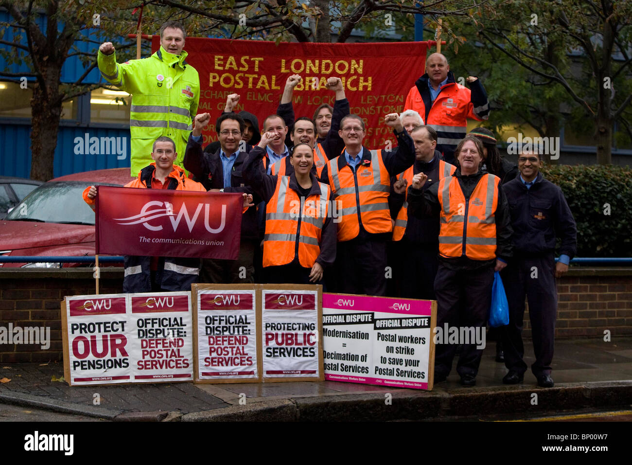 Striking Postal Workers picket outside Bow Delivery Office in East London. Picture by James Boardman - Stock Image