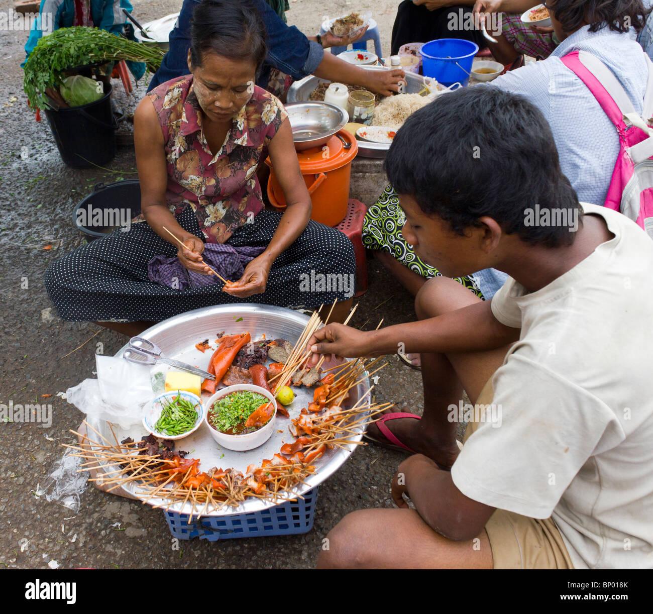 manual labourer eating lunch at stand, Yangon docks, Myanmar - Stock Image