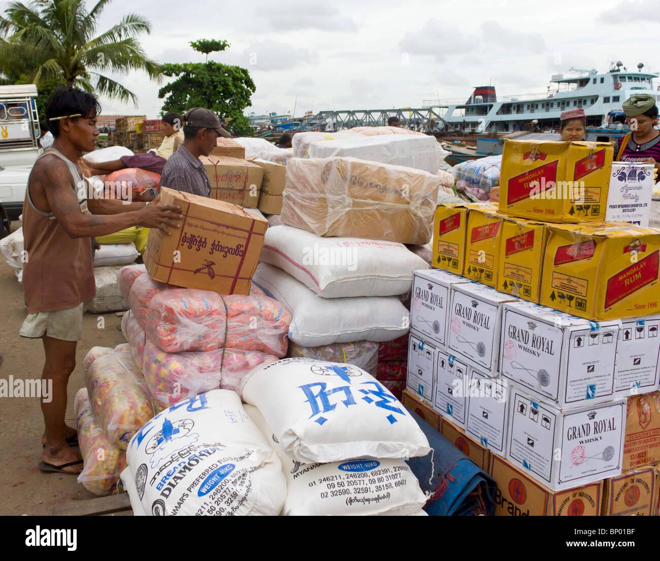manual labourer stacking boxes, Yangon docks, Myanmar - Stock Image