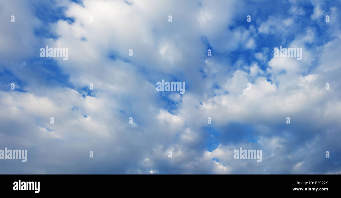 White cumulus clouds in the summer blue sky Stock Photo